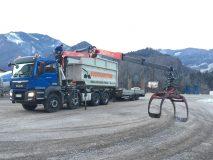 Containerdienst mit Hakenwagen